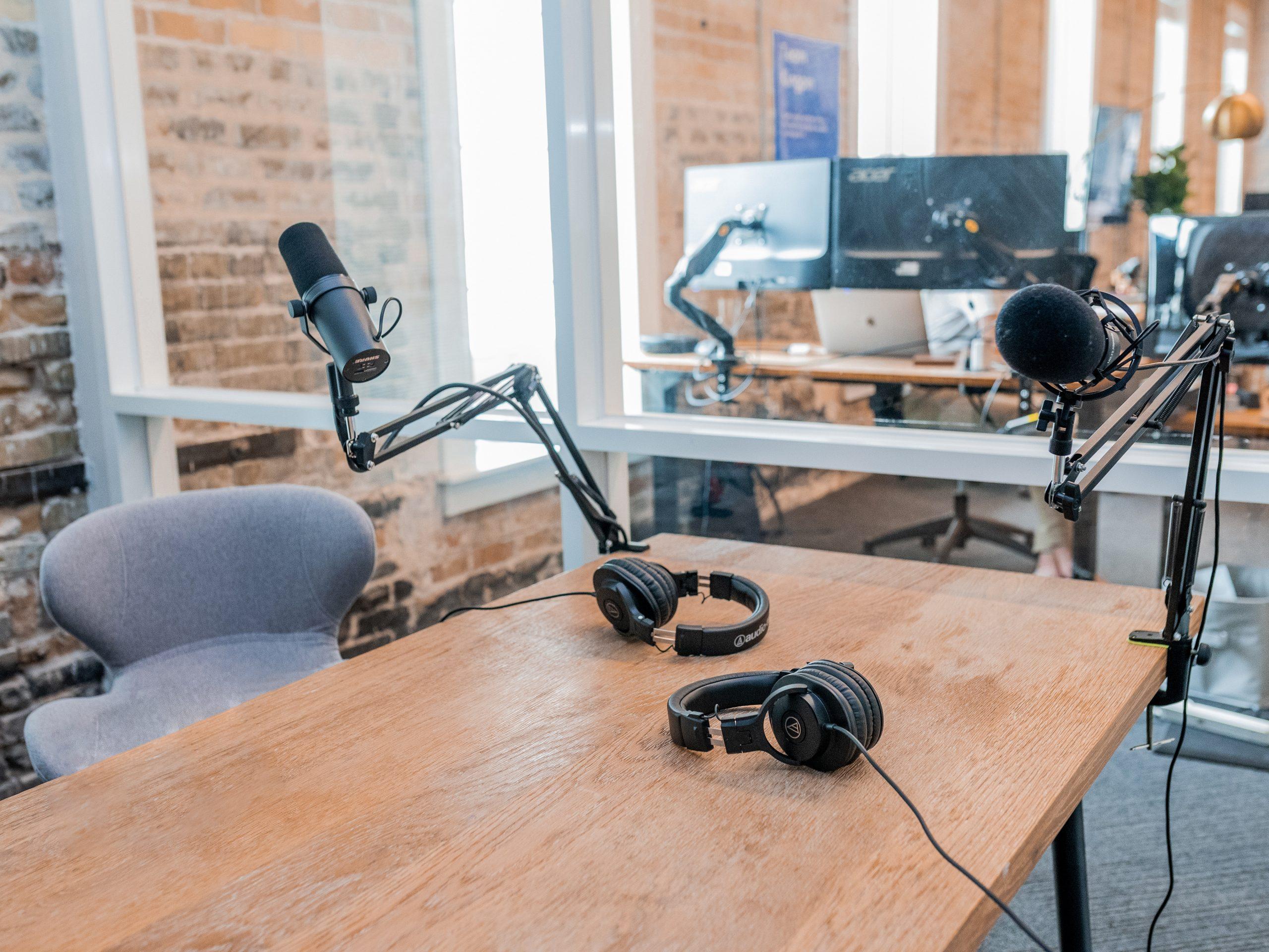 two black headphones on brown wooden table